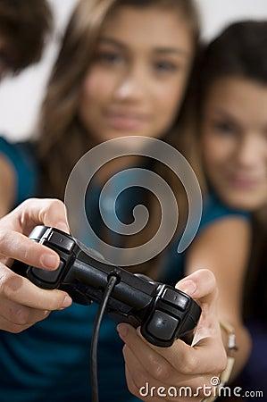 Girls playing video game