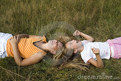 Girls plays on a meadow III