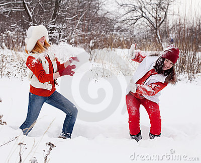 Girls plays with snow
