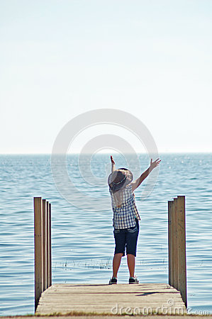 Girls Praising God On Dock