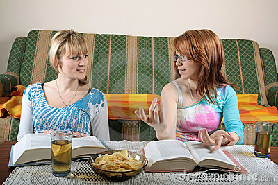 Girls reading books and discussing
