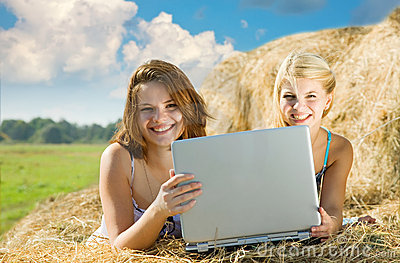 Girls relaxing with laptop