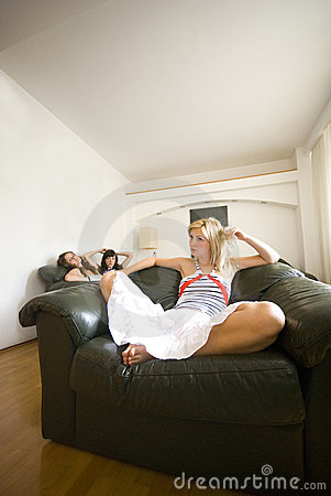 Girls relaxing in living room