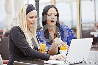 Girls in restaurant with laptop