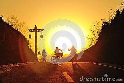 Girls riding bicycle on the sunset