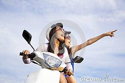 Girls riding scooter enjoy summer vacation