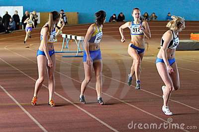 Girls run relay race Editorial Stock Image