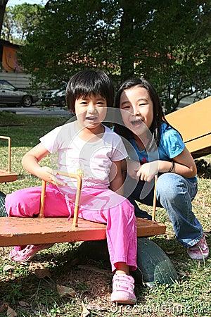 Girls on seesaw