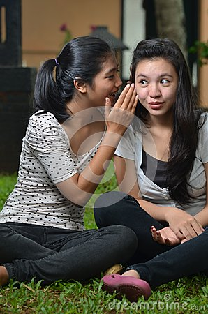 Girls sharing story or gossip
