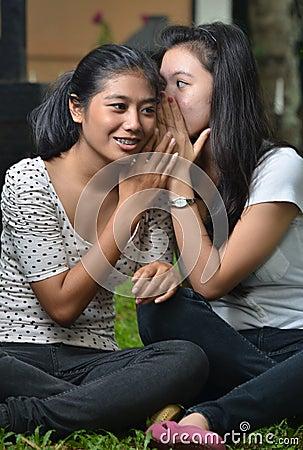Girls sharing story or gossip