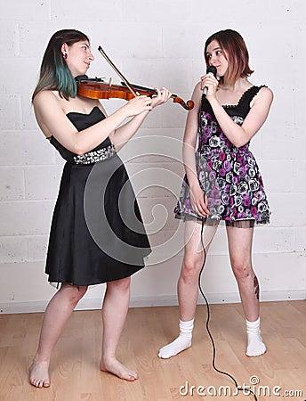 Girls singing and playing violin