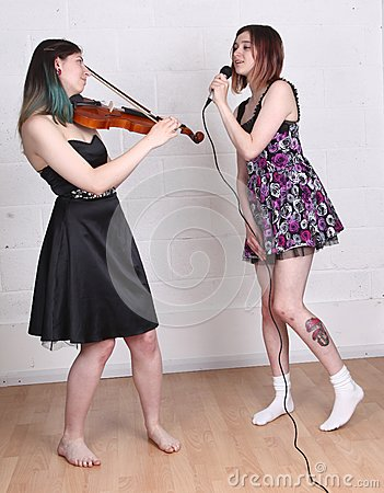 Girls singing and playing violin