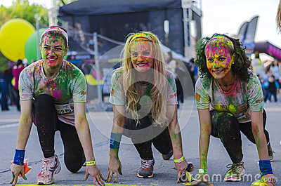 Girls smiling with colored powder Editorial Photo