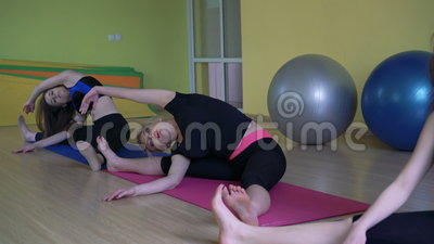 yoga class doing cobra upward dog pose together on