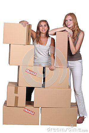 Girls surrounded by boxes