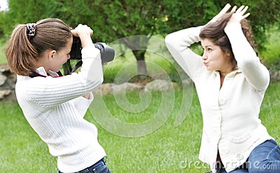 Girls taking pictures on nature