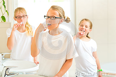 Girls tooth brushing in the bath room