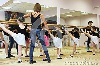 Girls trains with ballet teacher Editorial Image