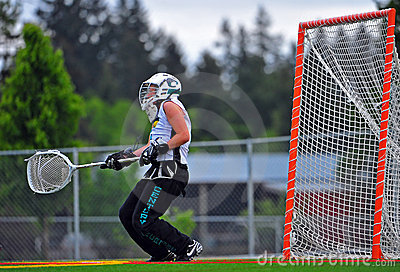 Girls Varsity Lacrosse goalie taking a hit Editorial Photography