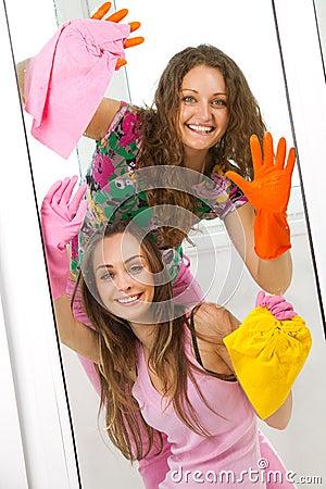 Free Girls Washing The Window Stock Photo - 19793150