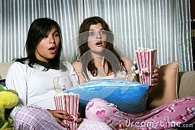 Girls watching horror movie