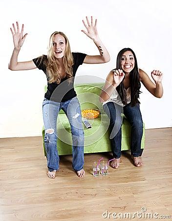 Girls watching TV sports