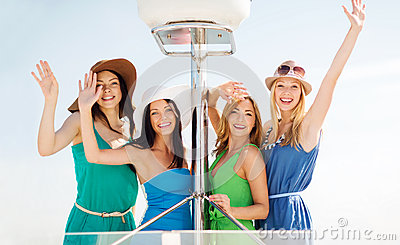 Girls waving on boat or yacht