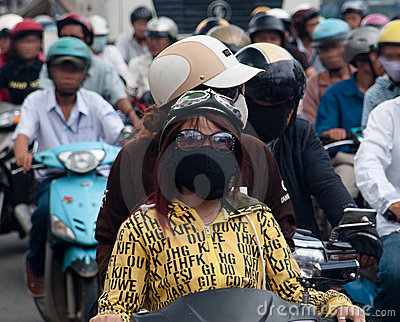 Girls wearing face mask in polluted Saigon Editorial Stock Photo