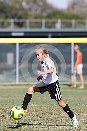Girls Youth Soccer Football Player Kicking the Ball Editorial Stock Image