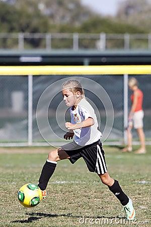 Girls Youth Soccer Football Player Kicking the Ball