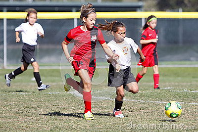 Girls Youth Soccer Football Players Running for the Ball Editorial Photo