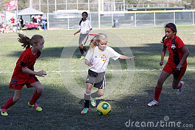 Girls Youth Soccer Football Players Running for the Ball Editorial Photography