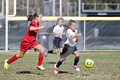 Girls Youth Soccer Football Players Running for the Ball Editorial Image