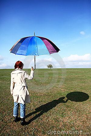 Girlwith umbrella at field