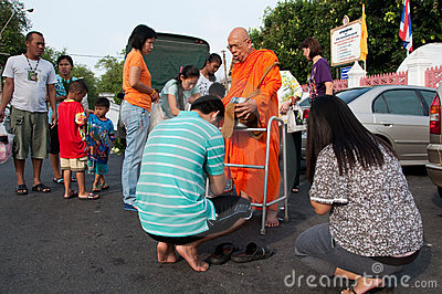 Give alms to a Buddhist monk 01 Editorial Image