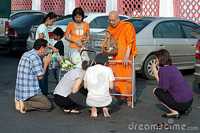 Give alms to a Buddhist monk 02 Editorial Stock Image