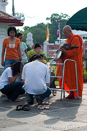 Give alms to a Buddhist monk 03 Editorial Photo