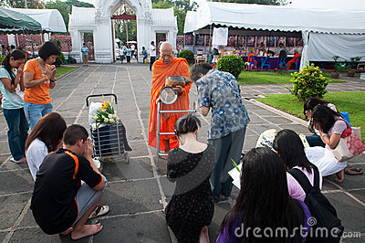 Give alms to a Buddhist monk 05 Editorial Stock Image
