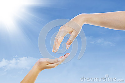 Give gesture under blue sky