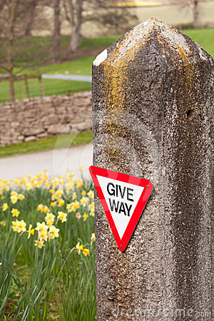 Give way sign on old stone gatepost