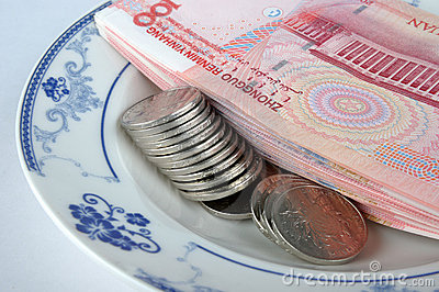 Giving money by plate as dish