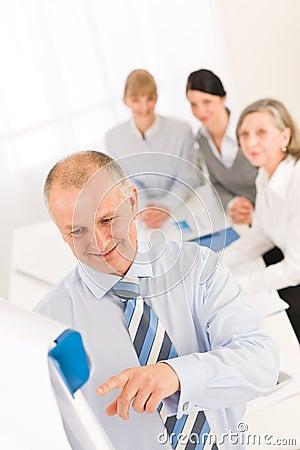 Giving presentation businessman point flip-chart
