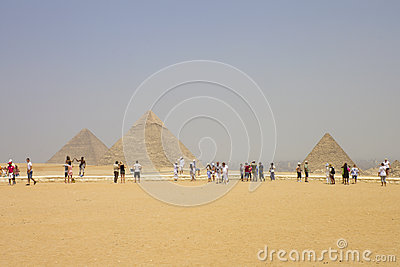 Giza - pyramids with the tourists admiring them Editorial Stock Photo