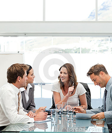 Glad businesswoman talking to her team