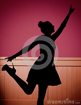 Glad young dancer on the dance floor