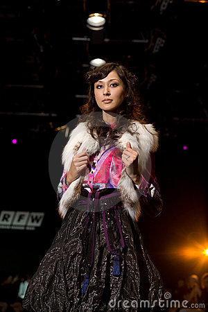 Glam female model at a fashion show(Russian Fashio Editorial Stock Photo