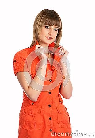 Glamor girl in a orange dress isolated