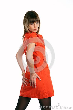 Glamor girl in a orange dress isolated