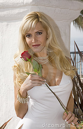Glamorous Blond woman Holding a Red Rose