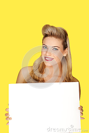 Glamorous blonde woman with a blank sign